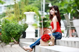 Beautiful asian girl sitting on the steps