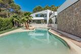 Luxury modern white villa and lagoon pool