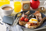 Breakfast-meat-eggs-mushrooms-tomatoes-orange juice-coffee