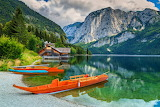 Boathouse and wooden boats on the lake Altaussee Salzkammergut A