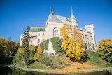 Castle with pond in autumn colors