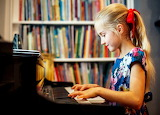 A girl plays the piano