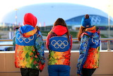 people wearing coats with Olympics symbol