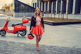 blonde girl with scooter