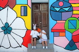 Door-couple-masks-painted-wall-art