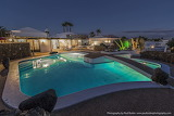 Luxury white finca and pool at night in Lanzarote