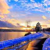 Sunset on Lake Coeur d'Alene lined with snow