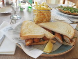 ^ Fish finger sandwich, served in chunky bread with tartare sauc