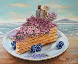 couple sitting on top of cake