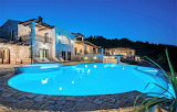 Rustic stone villa and pool in Greece at night