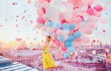 Girl with rainbow balloons