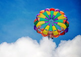 Colorful parachute, people, sky, clouds
