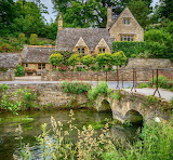 ^ Cotswolds at Bibury on the River Coln