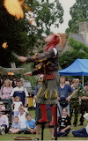 Wallingford Charter day fire eater on Castle site 30 July 2005