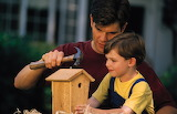 Father and son make a birdhouse