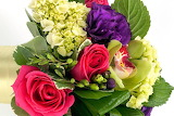 ^ Pink Kiko roses, rich purple lisianthus, mini green hydrangea