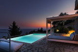 Luxury sea view pool and terrace at sunset