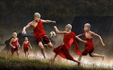 Monk soccer players sport ball men