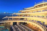 Cruise ship stern lit by evening sun