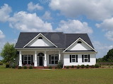 4944096-one-story-small-residential-home-with-board-siding-on-th