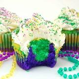 ^ Mardi Gras cupcakes and beads
