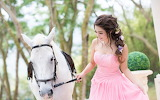Happy-Asian-girl-and-horse-pink-dress