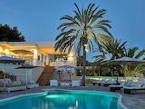Luxury modern white villa and pool at dusk
