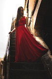 Long Red Gown on the Stairs