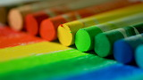 Rainbow line of crayons