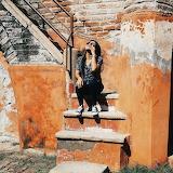 Feeling the Sun on Orange Stairs