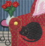 Black cat a on red chair