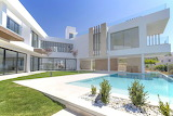 Designer white glass and concrete villa and pool