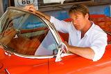 Man in red corvette