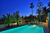 Luxury villa pool and terrace at night