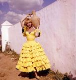 Brigitte Bardot in yellow spanish dress