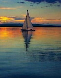 Lone Sail in the sunset