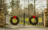 ^ Christmas decorated wrought iron fence