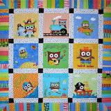 happy owls cot quilt