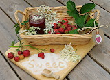 basket with jam and fruit
