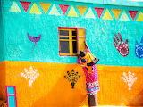 Painted wall, window, woman, Egypt