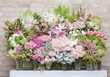 ^ Flower display in pinks, white, green