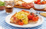 Breakfast, sliced bread, bacon, scrambled eggs, tomatoes