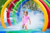 Water park, little girl, fun, water jets, summer