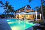 Luxury tropical villa and pool at night