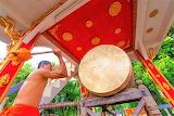 Monk sounding a gong