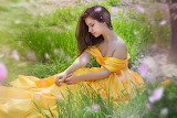 girl sitting on grass, yellow dress