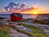 Red wooden cottage with sunset