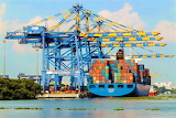 cranes and container ship