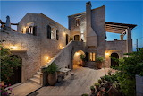 Beautiful restored stone house and courtyard garden at night