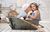 Little-girls-boys-children-umbrella-bucket-kiss